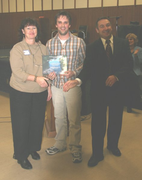 cathie_receiving_award_from_mnr_al_and_mark